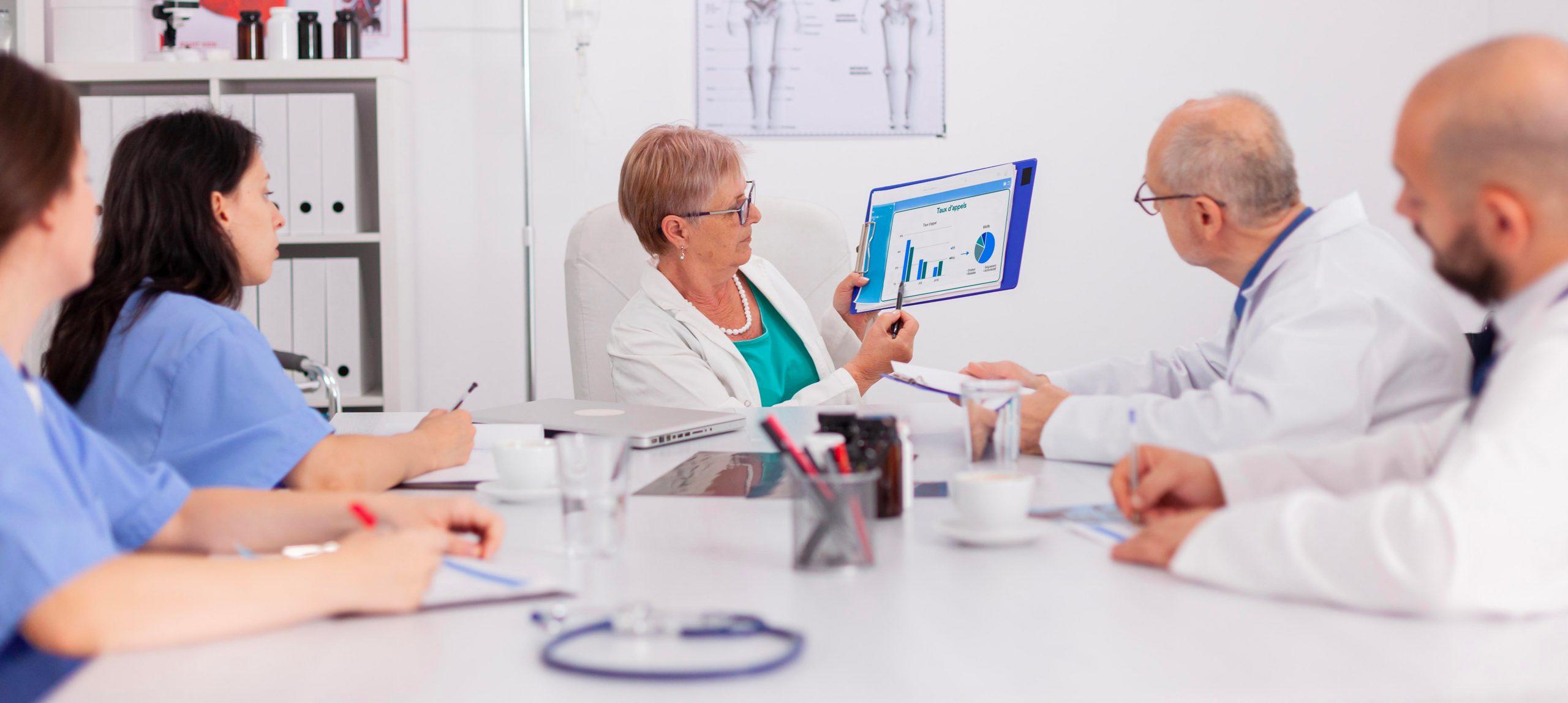 senior-pedia3trician2-woman-d5i1scussing-sickness-treatment-using-clipboard-for-medical-presentation